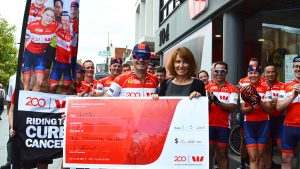 Marie Ranson receiving a donation from Tour de Cure