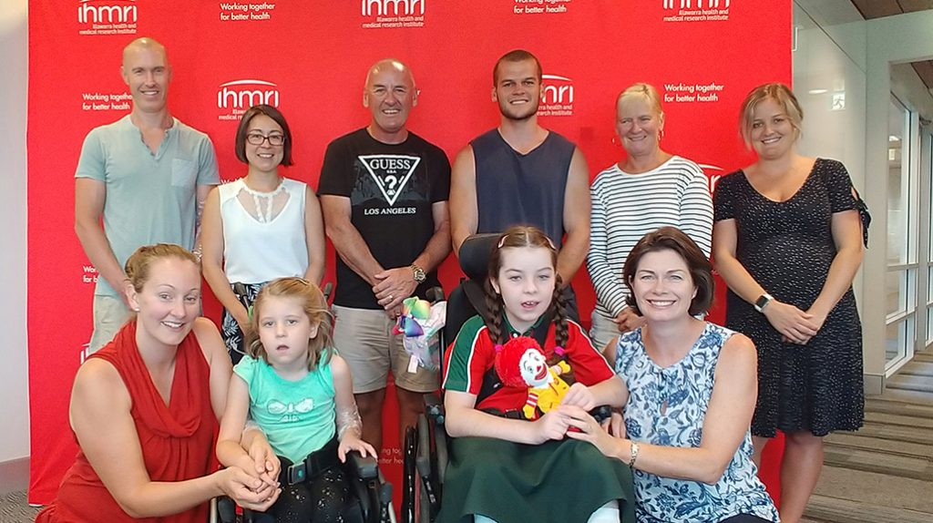 Back row: Daniel Burns, IHMRI Neuroscientist Dr Lezanne Ooi, Great Illawarra Walk founder Chris Lovatt, his son Christian Lovatt and wife Ruth Lovatt, and Emilie Wells. Front row: Amanda Burns, Holly Burns, Chloe Saxby and Nyree Saxby.
