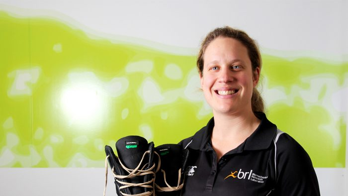 Jess Dobson holding her new work boots for miners