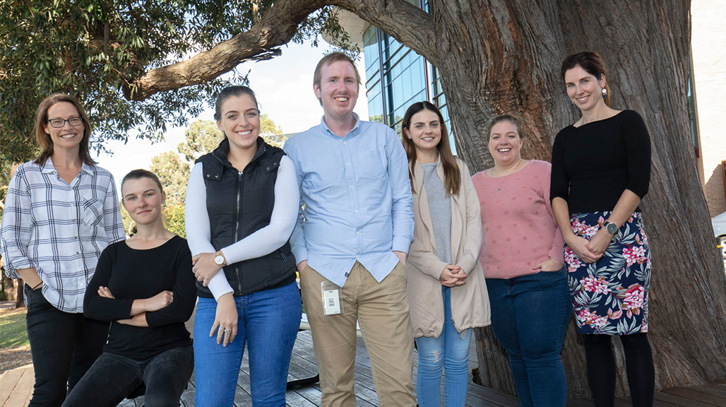 The MND Genies with Professor Justin Yerbury's research team. PhD candidate Christen Chisholm, Honours student Victoria Sheppard, Jessica Ellis, Research Associate Dr Luke McAlary, Rebecca Young, Kaitlin Ellis and Senior Research Assistant Natalie Farrawell. Photo by Mark Newsham.