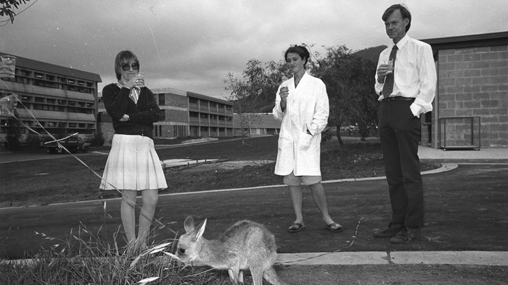 October 1978. Animal House and Department of Biology staff - Diane Kelsey, Linda Deitch and Professor Duncan Brown. Wallaby eating grass.